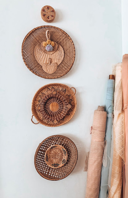 boho basket wall with pastel vintage lace on bolts