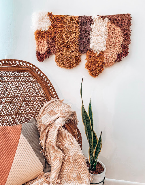 boho modern latch hook tapestry and peacock chair reading nook