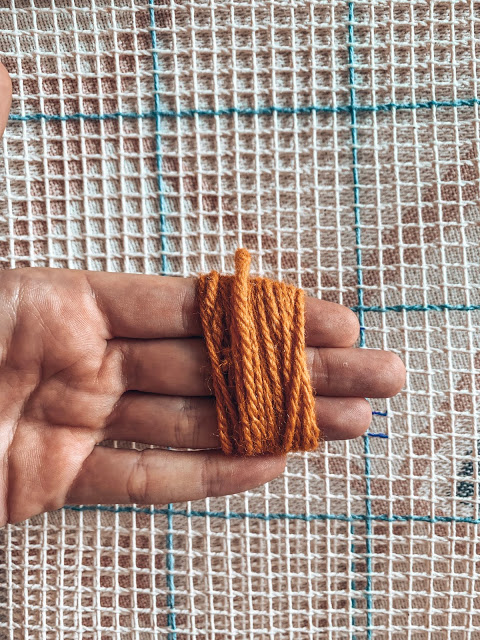 cut your yarn for your latch hook piece