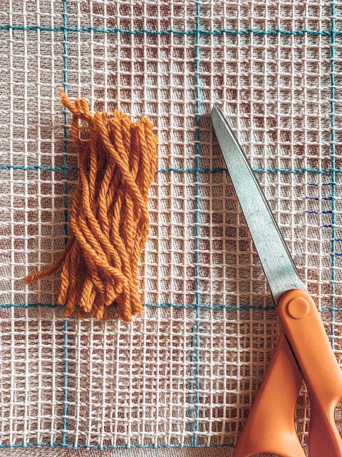 yarn pieces that will create your final latch hook piece