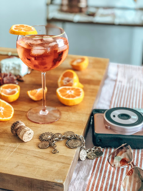 An aperol spritz styled on  charcuterie board